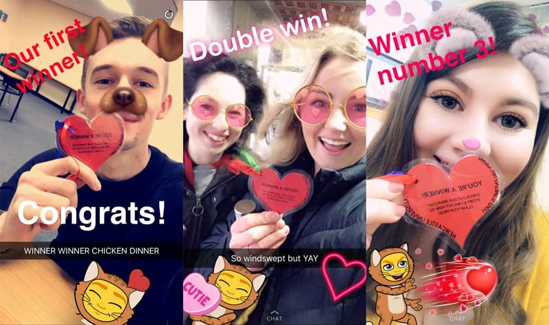 Student selfies holding the newcastle university snapchat heart hunt cards