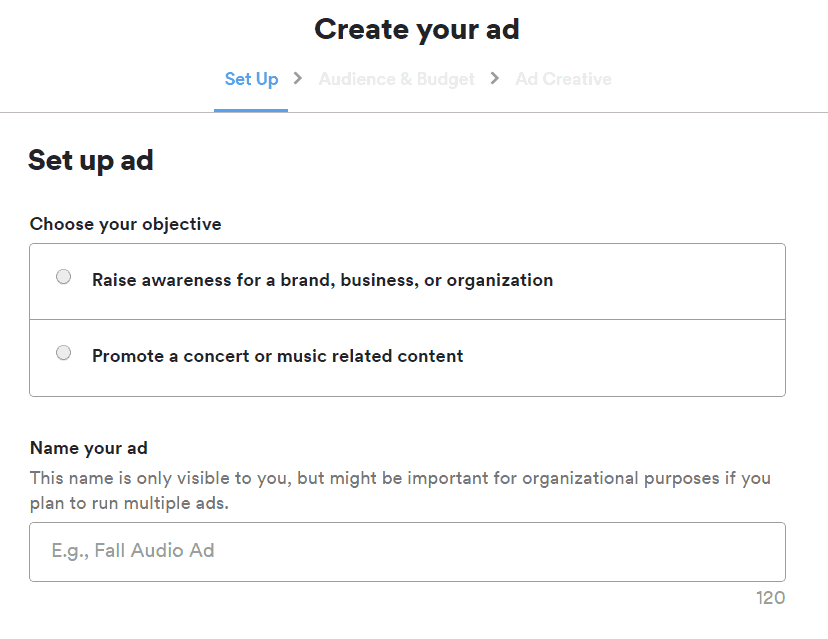 The create your ad screen for Spotify Ad studio offering the options to choose your objective for raising awareness of a brand or promoting a concert